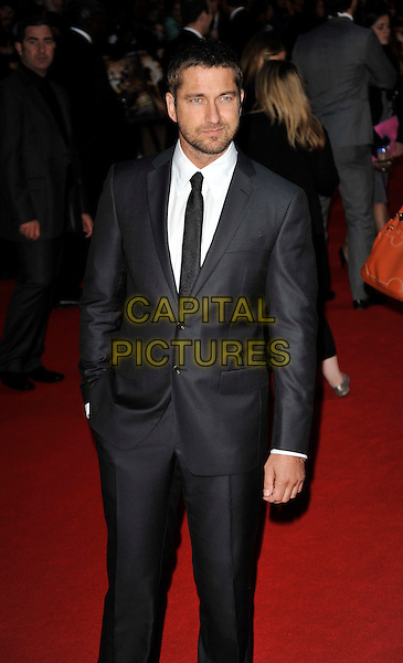 "GERARD BUTLER.Arrivals for the ""RocknRolla"" world film premiere held at the Odeon West End cinema, Leicester Square, London, England..September 1st, 2008.half 3/4 length black suit stubble facial hair .CAP/CAN.©Can Nguyen/Capital Pictures."