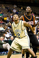 January 9, 2009:     Jacksonville forward Aric Brooks (22) positions himself for a rebound in Atlantic Sun Conference action between the Jacksonville Dolphins and the Mercer Bears at Veterans Memorial Arena in Jacksonville, Florida.  Jacksonville defeated Mercer 80-59.