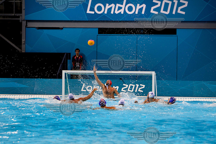 Men compete in the water polo competition at the Aquatics Centre in Stratford, at the London 2012 Olympic Games.