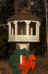 Birdhouse with christmas wreath