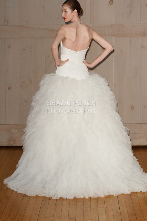 Model poses in a Zac Posen bridal gown for the David's Bridal Fall 2017 fashion show presentation on April 19, 2017; during New York Bridal Fashion Week.
