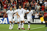 Team mates celebrate Jozy Altidore's goal with him...USA defeated Guadeloupe 1-0 in Gold Cup play at LIVESTRONG Sporting Park, Kansas City, Kansas.