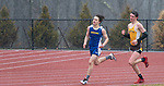 THOMASTON,  CT-040919JS14- Housatonic's Liam Money  overtakes Thomaston's Jack McMahon to take second place in the 800 meter run during their Berkshire League meet with Tuesday at Nystrom's Sports Complex in Thomaston.<br /> Jim Shannon Republican American