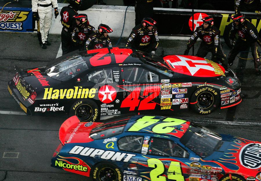Feb 18, 2007; Daytona, FL, USA; Nascar Nextel Cup Series driver Juan Pablo Montoya (42) and Jeff Gordon (24) on pit road during the Daytona 500 at Daytona International Speedway. Mandatory Credit: Mark J. Rebilas