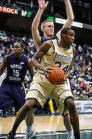 February 08, 2011:    Jacksonville Dolphins forward Keion Palmer (34) grabs a rebound during Atlantic Sun Conference action between the Jacksonville Dolphins and the North Florida Ospreys at Veterans Memorial Arena in Jacksonville, Florida.  Jacksonville defeated North Florida 71-69.