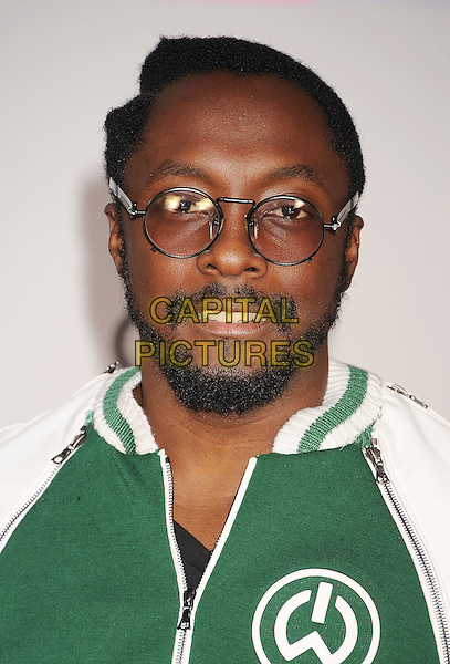 Will.I.Am.arriving at the 2011 American Music Awards held at Nokia Theatre at L.A. Live in Los Angeles, California, November 20th, 2011.  .arrivals AMA AMAs portrait headshot glasses beard facial hair  green baseball jacket .CAP/ROT/TM.©TM/Roth Stock/Capital Pictures
