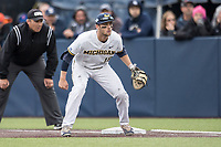 Michigan Wolverines first baseman Jake Bivens (18) on defense against the Michigan State Spartans on May 19, 2017 at Ray Fisher Stadium in Ann Arbor, Michigan. Michigan defeated Michigan State 11-6. (Andrew Woolley/Four Seam Images)