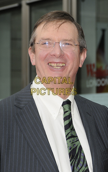 "MIKE NEWELL, Director .At the World Film Premiere of ""Prince of Persia: The Sands Of Time"", Vue cinema at Westfield shopping centre, London, England, 9th May 2010..arrivals portrait headshot grey gray suit green tie glasses smiling  .CAP/CAN.©Can Nguyen/Capital Pictures."