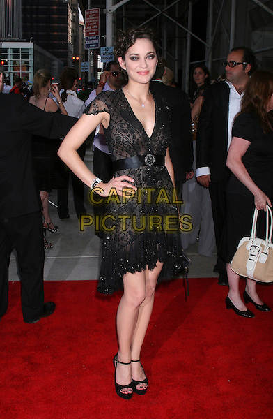 "MARION COTILLARD.At the ""La Vie En Rose"" Premiere at the Paris Theater, New York, NY, USA. .May 31st, 2007.full length black lace dress hand on hip shoes.CAP/IW.©Ian Wilson/Capital Pictures"