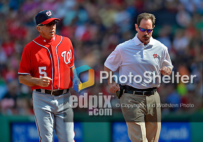 10 June 2012: Washington Nationals Head Athletic Trainer Lee Kuntz trots back to the dugout after checking the status of catcher Jesus Flores during action against the Boston Red Sox at Fenway Park in Boston, MA. The Nationals defeated the Red Sox 4-3 to sweep their 3-game interleague series. Mandatory Credit: Ed Wolfstein Photo