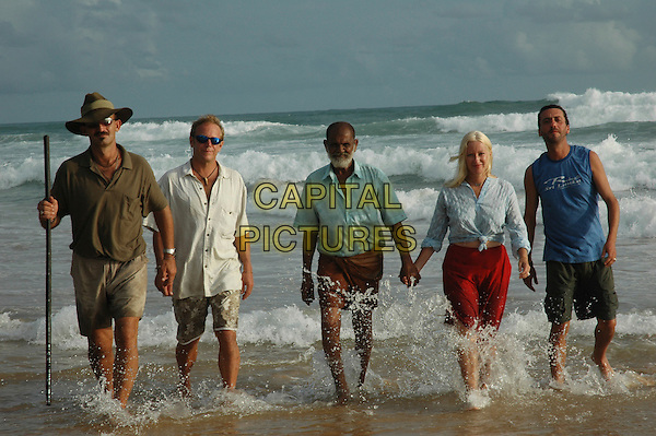 DONNY (from Australia), BRUCE (from Colorado) join the chief of the village in Sri Lanka and filmmakers ALISON THOMPSON (from New York) and OSCAR GUBERNATI (from New York via Naples, Italy) for a moment on the beach .in The Third Wave.*Filmstill - Editorial Use Only*.CAP/PLF.Supplied by Capital Pictures.