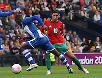 Men's Olympic Football match Honduras v Morocco on 26.7.12...Abdelaziz Barrada of Morocco fouls Jose Velasquez of Honduras , during the Honduras v Morocco Men's Olympic Football match at Hampden Park, Glasgow..........