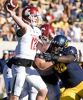 Jacobi Hunter of California puts a lot of pressure on Washington State quarterback Connor Halliday during the game at Memorial Stadium in Berkeley, California on October 5th, 2013.  Washington State defeated California, 44-22.