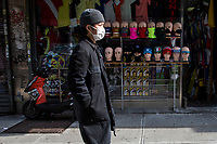 NEW YORK, NY - APRIL 25: A man walks near a clothing store on April 25, 2020 in Queens, NY. The immigrant community in Queens has been severely affected by COVID-19, the neighborhood is overwhelmed by the number of deaths and infections during recent months, reaching the point of being considered one of the most devastated places by the desease in the U.S. and the world. (Photo by Pablo Monsalve/VIEWpress)