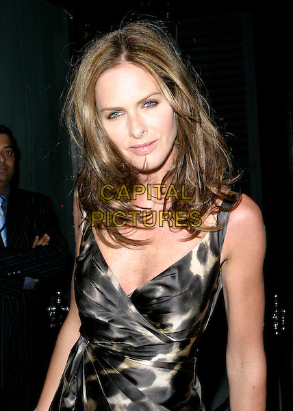 TRINNY WOODALL.Arrivals at Jimmy Choo's 10th Anniversary Party during London Fashion Week, Tamarai, Drury Lane, London, England, September 18th 2006..half length silk satin leopard spot print dress.Ref: AH.www.capitalpictures.com.sales@capitalpictures.com.©Adam Houghton/Capital Pictures.