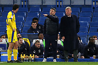 AFC Wimbledon's Interim Manager, Simon Bassey issues some instructions as the new AFC Wimbledon Manager, Wally Downes looks on during Chelsea Under-21 vs AFC Wimbledon, Checkatrade Trophy Football at Stamford Bridge on 4th December 2018