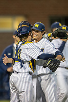 Michigan Wolverines pitcher Keaton Carratini (28) and catcher Casey Buckley (24) celebrate after the NCAA baseball game against the Eastern Michigan Eagles on May 8, 2019 at Ray Fisher Stadium in Ann Arbor, Michigan. Michigan defeated Eastern Michigan 10-1. (Andrew Woolley/Four Seam Images)