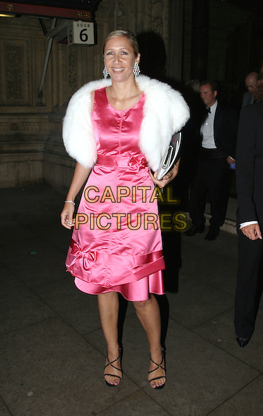 TANIA BRYER.Cirque Du Soleil charity performance at the Royal Albert Hall and aftershow dinner at the V&A Museum.5 February 2004.full length, full-length, bright pink satin fifties style dress, fur wrap collar, black strappy sandals, bow, ribbon.www.capitalpictures.com.sales@capitalpictures.com.© Capital Pictures.
