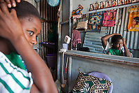 """Emily Aluoch, 27, says the single biggest challenge to her hairdressing business is the stiff competition nearby. """"We are getting customers a day, but there are several other hairdressers near here and we have to work hard to be the best""""."""