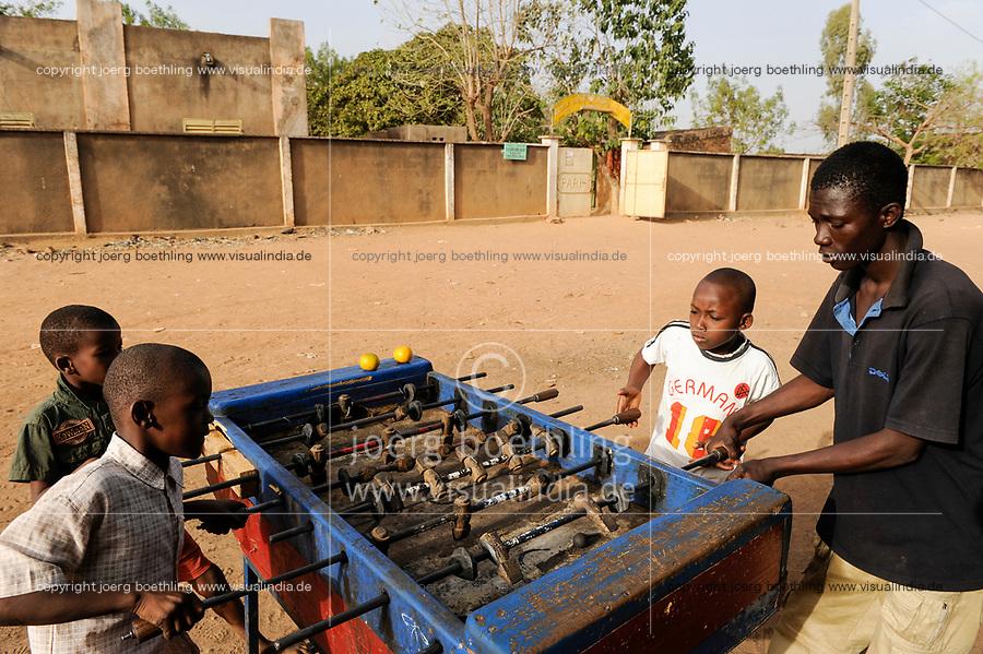 MALI, Bamako , suburban Kalabancoura, children play table football on the street