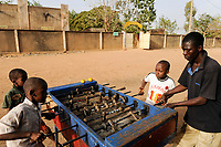 MALI, Bamako , suburban Kalabancoura, children play table football on the street