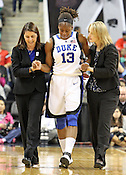 Karima Christmas is helped off the court after a bad fall. This was the Championship game of the 2011 ACC Tournament in Greensboro on March 6, 2011. Duke beat UNC 81-66. (Photo by Al Drago)
