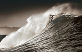 USA, Hawaii, man surfs a large wave on an outer reef, the North Shore of Oahu (B&W)