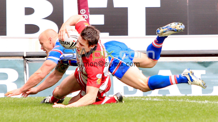 Pix: Chris Mangnall /SWPix.com, Rugby League, Super League. 05/04/10 Wigan Warriors v Wakefield Trinity Wildcats....picture copyright>>Simon Wilkinson>>07811267 706>>....Wigan's 4th try  Joel Tomkins avoids Wakefield's Damien Blanch to score