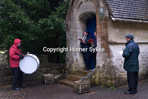 Bisley Village Silver Band. Waiting for school chidren to come out of the church. Well Dressing Bisley Gloucestershire UK 2015