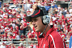 Jim Harbaugh, Stanford Cardinal head coach, removes his headset after talking with his staff in the booth during Stanford's Pac-10 conference football game against Washington State at Martin Stadium in Pullman, Washington, on September 5, 2009.  The Cardinal prevailed over the Cougars, 39-13.