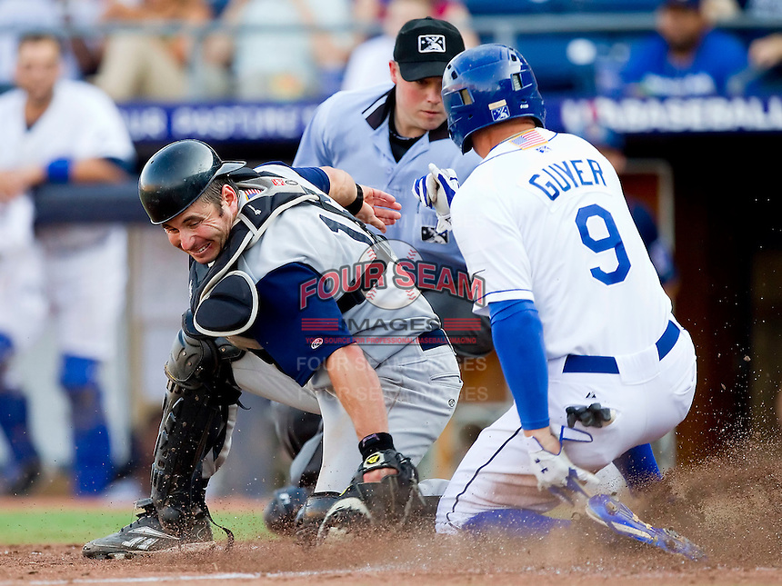 Brandon Guyer #9 of the Durham Bulls beats the tag from catcher Adam Ricks #16 of the Charlotte Knights to score the winning run in the bottom of the 8th inning at Durham Bulls Athletic Park on August 28, 2011 in Durham, North Carolina.  The Bulls defeated the Knights in Game One of a double header 4-3 in 8 innings.   (Brian Westerholt / Four Seam Images)
