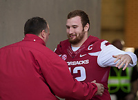 Hawgs Illustrated/BEN GOFF <br /> Bret Bielema, Arkansas head coach, hugs center Frank Ragnow during recognition of senior players before the game against Missouri Friday, Nov. 24, 2017, at Reynolds Razorback Stadium in Fayetteville.