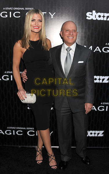 "Montana Albrecht, Chris Albrecht.The Los Angeles Series Premiere of ""'Magic City"" at the Directors Guild of America in Los Angeles, California, USA..March 20th, 2012.full length grey gray black white suit dress.CAP/ROT/TM.©Tony Michaels/Roth Stock/Capital Pictures"