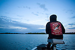 Crystal Greene from Winnipeg and Shoal Lake  fishes on Shoal Lake in Manitoba at dusk. The Energy East Pipeline would not run through Shoal Lake but nearby. Shoal lake is the source of drinking water for the city of Winnipeg. Ms. Greene is a activist that is dedicating her time to stopping the Energy East pipeline. (Credit: Robert van Waarden - http://alongthepipeline.com)