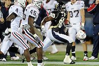 5 December 2009:  FIU wide receiver Jason Frierson (80) evades Florida Atlantic linebacker Michael Lockley (45) and defensive back Erick McIntosh (4) in the second half as the Florida Atlantic University Owls defeated the FIU Golden Panthers, 28-21, in the annual Shula Bowl game at FIU Stadium in Miami, Florida.