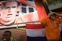 A Netherlands fans (right) reacts to Holland player Arjen Robben missing a shot on goal in the second half.  Robben is on the screen at left.  The 2010 FIFA World Cup Final between Spain and Holland happened at Soccer City in Soweto, South Africa on Sunday, July 11, 2010.  Spain defeated Netherlands 1-0.