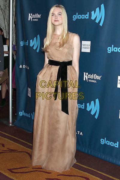 Elle Fanning.24th Annual GLAAD Media Awards held at JW Marriott LA LIVE, Los Angeles, California, USA..April 20th, 2013.full length dress black sleeveless sheer beige nude  belt sash.CAP/ADM/RE.©Russ Elliot/AdMedia/Capital Pictures.