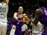 Phoenix player Diana Taurasi (3) passes to teammate Barbara Farris (54) during the WNBA game between the San Antonio Silver Stars and the Phoenix Mercury, May 20, 2008, at the AT&T Center, San Antonio, Texas. San Antonio won 81 - 76. (Darren Abate/PressPhotoIntl.com)