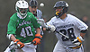 Angelo Petrakis #28 of Massapequa, right, and Brian Michael #40 of Farmingdale battle for possession of a faceoff during a Nassau County varsity boys lacrosse game at Massapequa High School on Friday, April 27, 2018. Massapequa won by a score of 7-4.