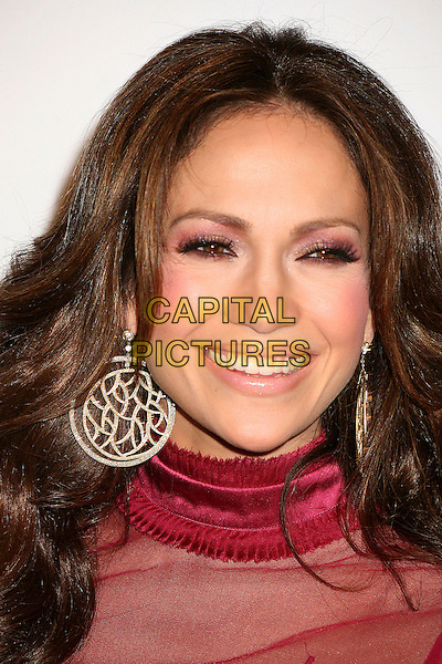 JENNIFER LOPEZ.Attends the Friends of the LA Free Clinic Annual Dinner Gala at The Beverly Hilton Hotel, Beverly Hills, California, USA, 20 November 2006..portrait headshot red top dress gold hoop circle disc earrings pink eyeshadow make-up blusher.CAP/ADM/BP.©Byron Purvis/AdMedia/Capital Pictures.