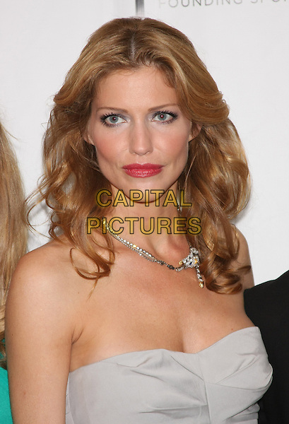 "TRICIA HELFER .The 2010 Tribeca Film Festival Premiere of ""Open House"" at the Clearview Chelsea Theater, New York, NY, USA..April 24th, 2010.headshot portrait grey gray strapless silver necklace pink lipstick make-up beauty .CAP/LNC/TOM.©TOM/LNC/Capital Pictures."
