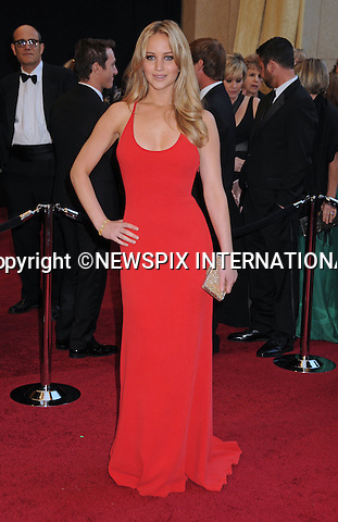 """JENNIFER LAWRENCE - Oscars 2011.83rd Academy Awards arrivals, Kodak Theatre, Hollywood, Los Angeles_27/02/2011.Mandatory Photo Credit: ©Phillips-Newspix International..**ALL FEES PAYABLE TO: """"NEWSPIX INTERNATIONAL""""**..PHOTO CREDIT MANDATORY!!: NEWSPIX INTERNATIONAL(Failure to credit will incur a surcharge of 100% of reproduction fees)..IMMEDIATE CONFIRMATION OF USAGE REQUIRED:.Newspix International, 31 Chinnery Hill, Bishop's Stortford, ENGLAND CM23 3PS.Tel:+441279 324672  ; Fax: +441279656877.Mobile:  0777568 1153.e-mail: info@newspixinternational.co.uk"""