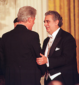 "Placido Domingo shakes hands with U.S. President Bill Clinton following his performance at the State Dinner in honor of King Juan Carlos I of Spain at the White House in Washington, D.C. on February 23, 2000.  While he was performing, Domingo was being awarded with a ""Grammy"" for best Mexican-American Performance: ""100 Anos de Mariachi""..Credit: Ron Sachs / CNP"