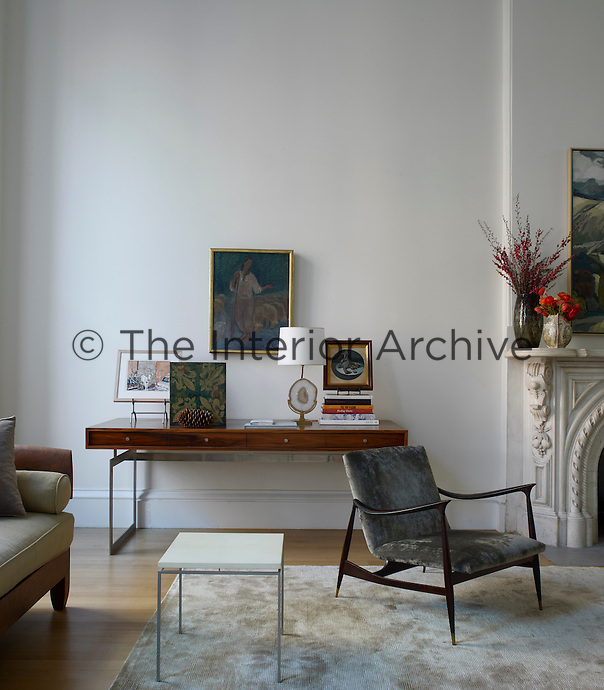 One corner of the living room is furnished with a Roman Thomas side table and a Brazilian 1930s armchair