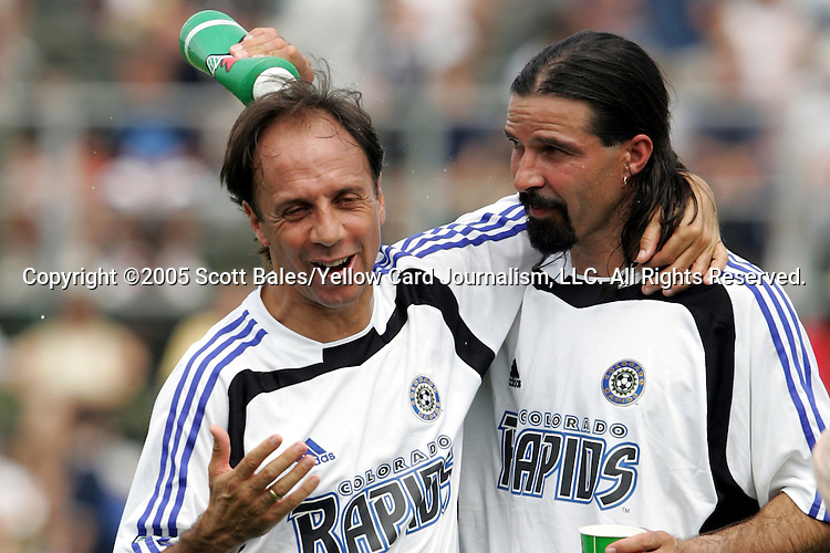 29 August 2005: Newly elected Hall of Famer and Colorado captain Marcelo Balboa (right) douses newly elected Hall of Famer and Colorado head coach Fernando Clavijo at halftime. The Colorado Rapids defeated DC United 6-2 at At-A-Glance Field in Oneonta, New York in the 2005 Hall of Fame Game..