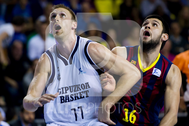 Gipuzkoa Basket Club's Charles Ramsdell (left) and FC Barcelona's Kostas Papanikolaou (right) during Liga Endesa ACB 2013-2014 match. November 3, 2013. (ALTERPHOTOS/Alex Caparros)