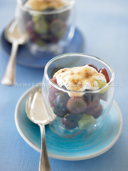 Grapes with yogurt in a glass, with spoon