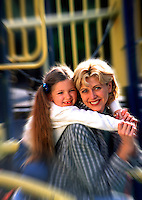 Mother and daughter portrait on playground