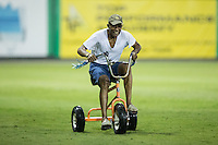 A fan competes in the giant tricycle race between innings of the Appalachian League game between the Princeton Rays and the Burlington Royals at Burlington Athletic Stadium on August 12, 2016 in Burlington, North Carolina.  The Royals defeated the Rays 9-5.  (Brian Westerholt/Four Seam Images)