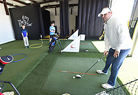 NWA Democrat-Gazette/FLIP PUTTHOFF <br /> EYE ON THE BALL<br /> Chris Murphy, golf and life skills coach at The First Tee of Northwest Arkansas, conducts a youth golf lesson on Saturday March 16 2019 at the golf facility in Lowell. Mission of The First Tee is to impact the lives of young people with programs that build character, instill values and promote healthy choices through the game of golf.